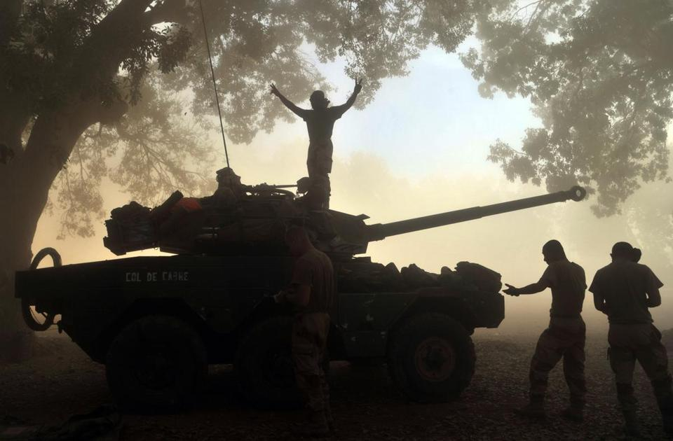 A French soldier proclaimed victory from a tank in Niono as Malian forces fought to recapture a town from Al Qaeda-linked fighters.