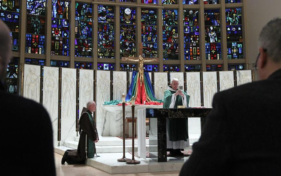 The Rev. Frank McHugh celebrated Mass at St. Anthony Shrine in Boston. The Rev. Joseph Nangle (kneeling) spoke.