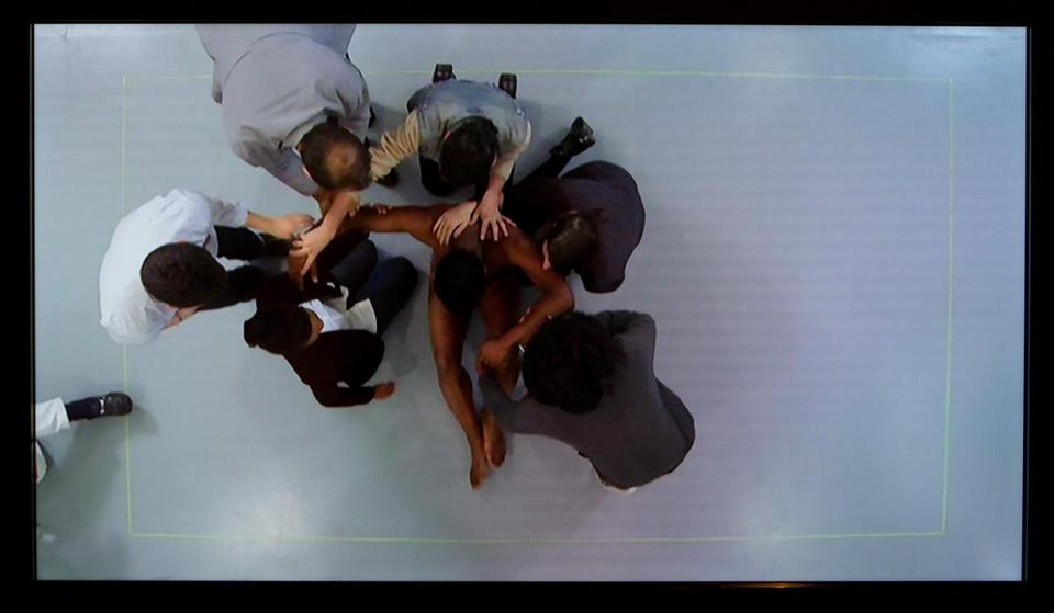 "A video still from Clifford Owens's performance ""Anthology (Maren Hassinger)."""