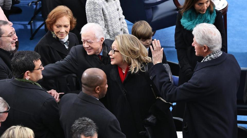 Former presidents Jimmy Carter and Bill Clinton and their wives, Rosalyn and Hillary, greeted people on the West Front of the Capitol.