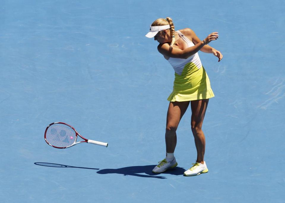 A frustrated Caroline Wozniacki is not very kind to her racket during her round of 16 loss.