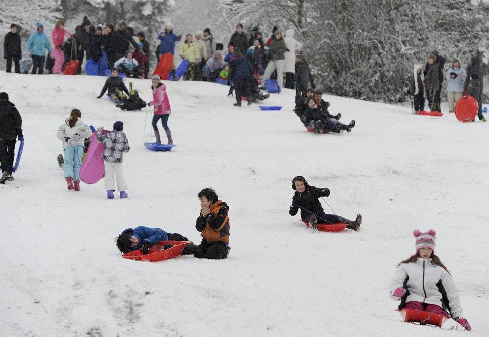 Children in northern England took advantage of the snow to have fun, but at airports the mood was not so cheery.