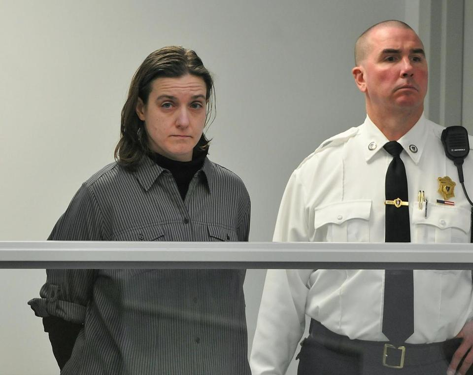Sonja Farak, left, stands during her arraignment at Eastern Hampshire District Court in Belchertown, on Jan. 22, 2013.