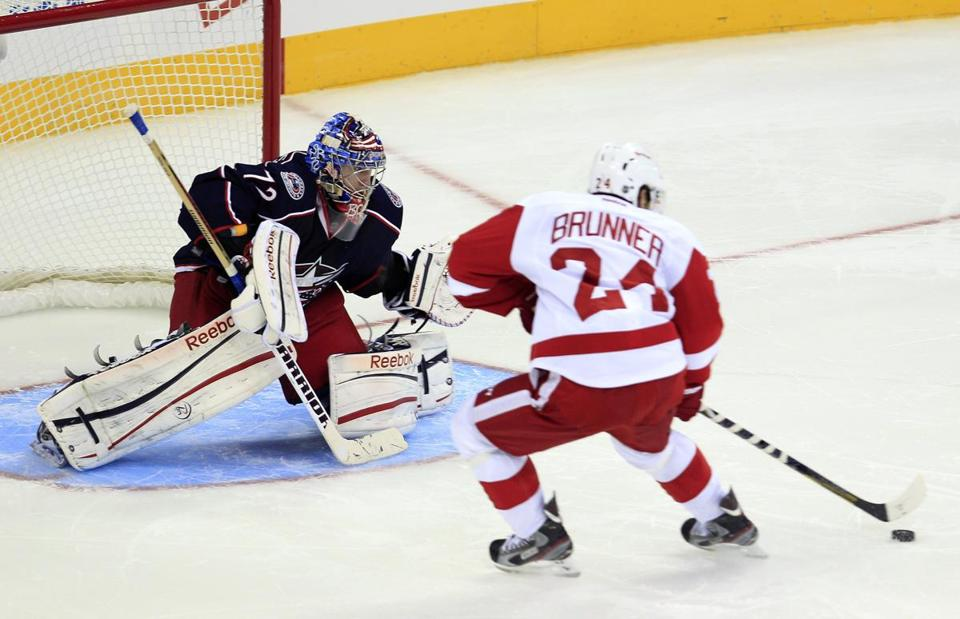 Detroit Red Wings' Damien Brunner, right, scored against Columbus Blue Jackets' Sergei Bobrovsky during the shootout Monday, Jan. 21, 2013, in Columbus, Ohio. The Red Wings beat the Blue Jackets 4-3.