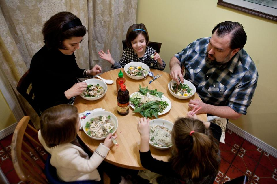 "The Kolodij family sat down to a dinner of Vietnamese Pho soup in their Newton home. John Kolodij, a former restaurant line cook, does the weekly meal planning. ""I try to run things so I'm not wasting food,"" he says."