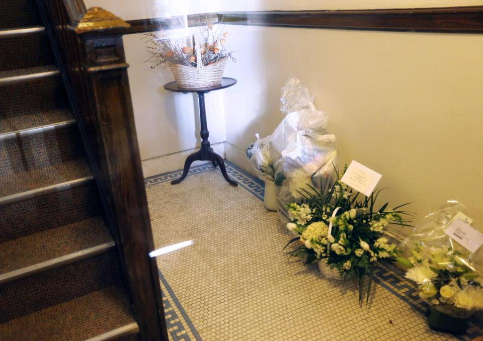 Flowers for the parents of Rehma Sabir were left in the entryway of their apartment building in Cambridge.