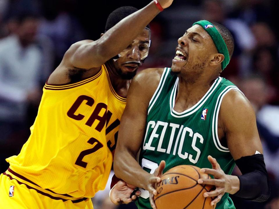 Kyrie Irving, who scored 40 points in the Cavaliers' win, also played a little defense, stopping Paul Pierce here.
