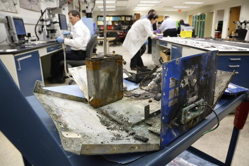 Federal investigators examined a damaged lithium ion battery and its case from a 787 that caught fire at Logan Airport.