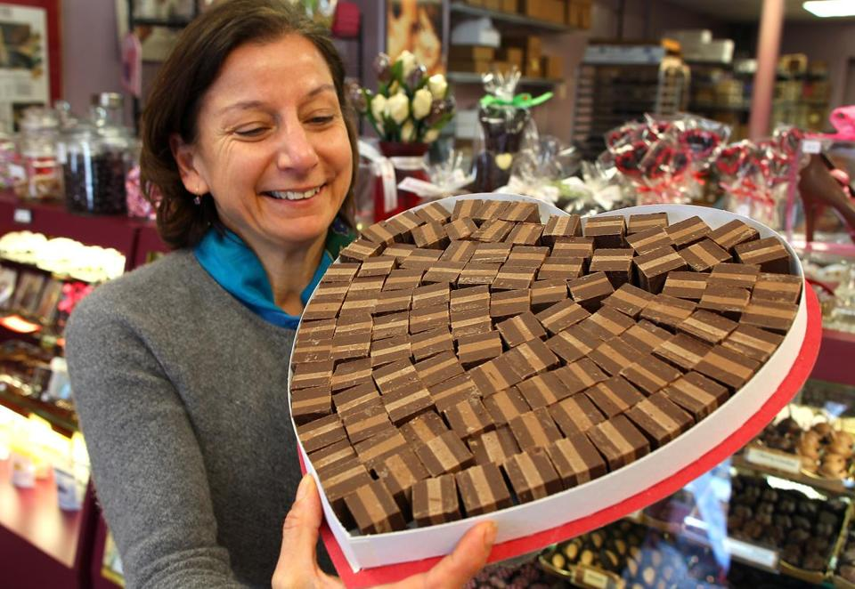 Nur Kilic at Serenade Chocolatier with a box of Viennese truffles, a candy she was having trouble making when she appealed to retired candymaker William Federer. He had been making candy then — and famously, truffles — for decades. Federer died in 2006 at 91.
