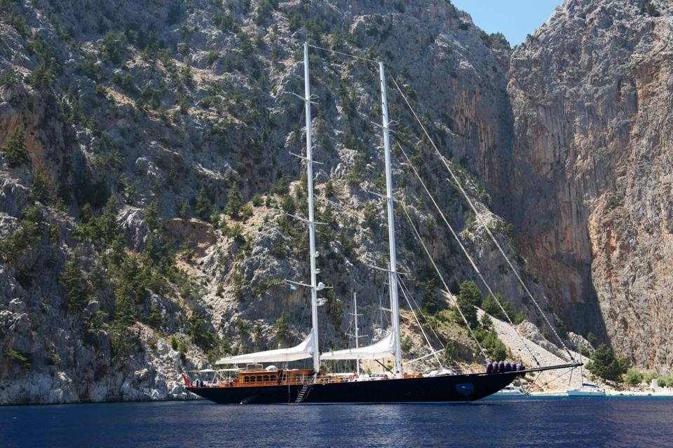 The 170-foot-long Regina idles in St. George's Bay on the island of Symi, Greece.