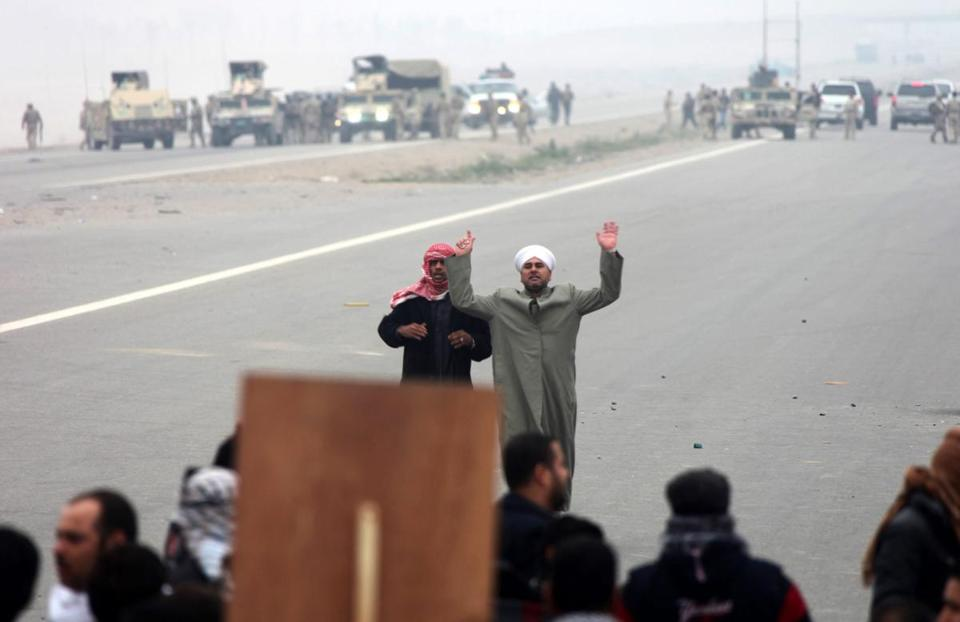 A Sunni cleric tried to calm protesters on Friday during antigovernment clashes with Iraqi soldiers in Fallujah.