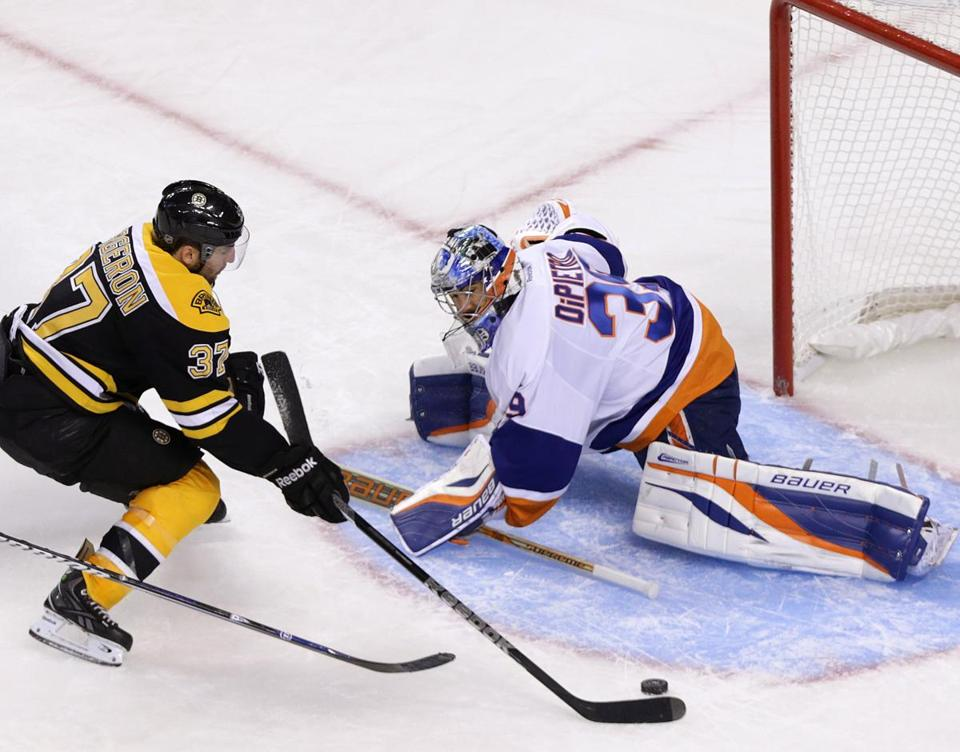 Patrice Bergeron provides some breathing room, beating goalie Rick DiPietro with a nifty move in the third period.
