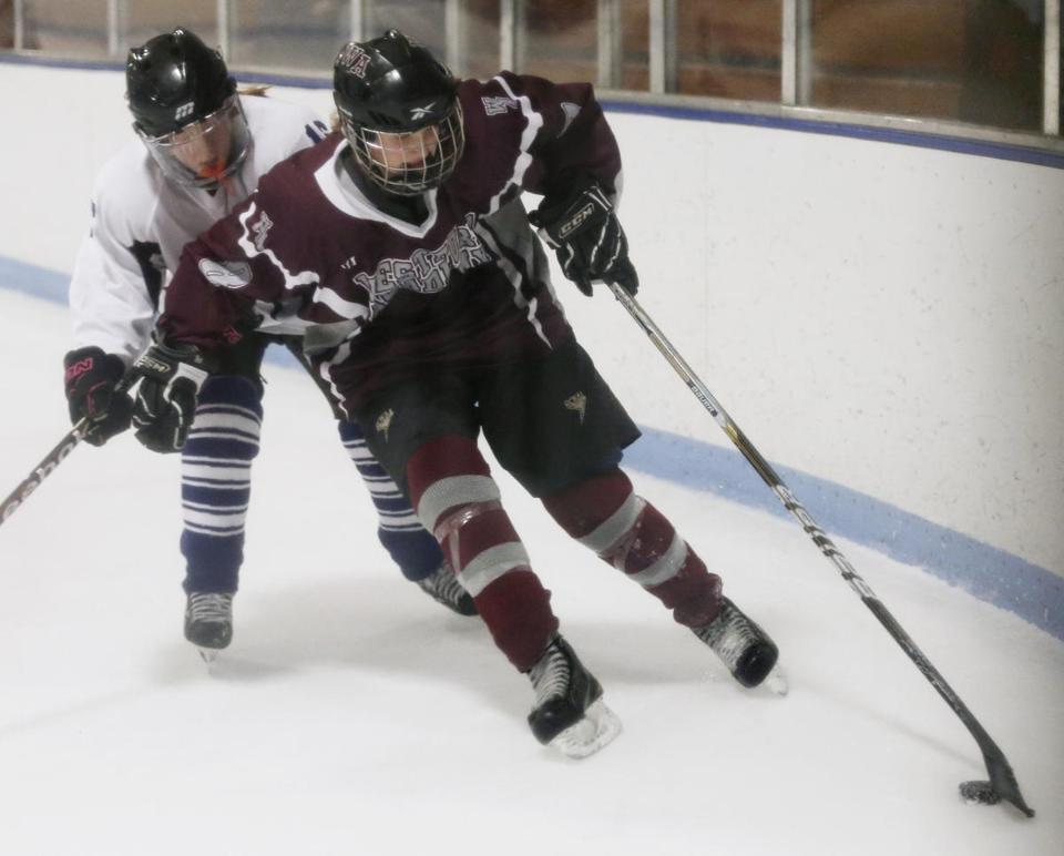 Westford Academy's Kim Lizotte carried the puck during their game against Tewksbury/Methuen.