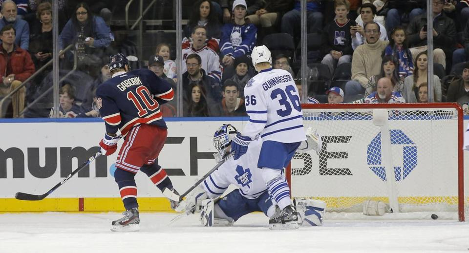 The Rangers' Marian Gaborik deflects a shot past Toronto goalie James Reimer for the decisive goal.