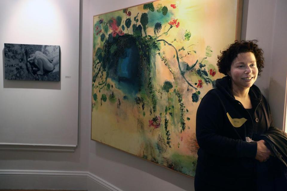 "Artist  Resa Blatman in front of Sarah Meyers Brent's mixed media and acrylic work ""Hanging Plant."""