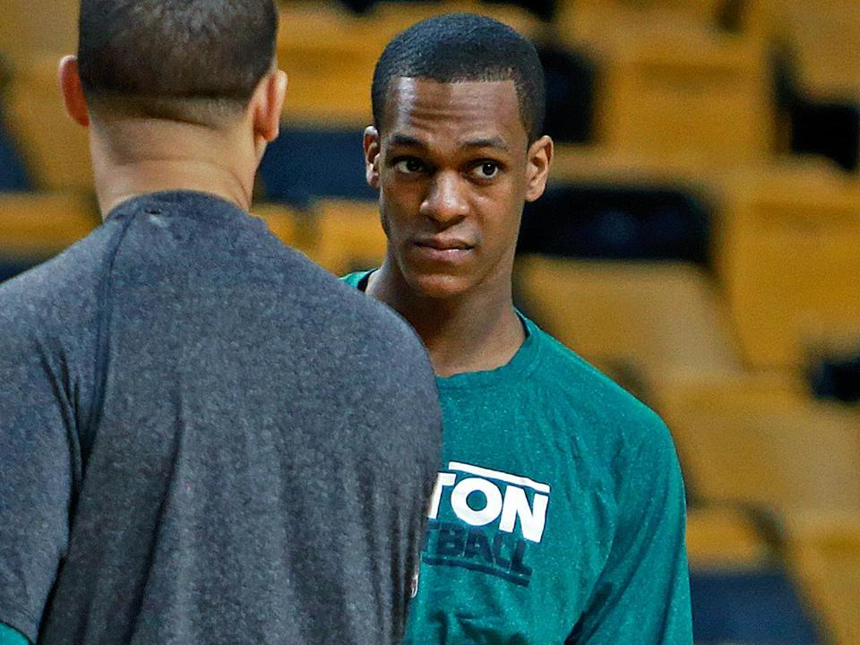 Rajon Rondo was only a spectator during warm-ups Sunday, before it was learned that the point guard was dealing with a torn ACL.