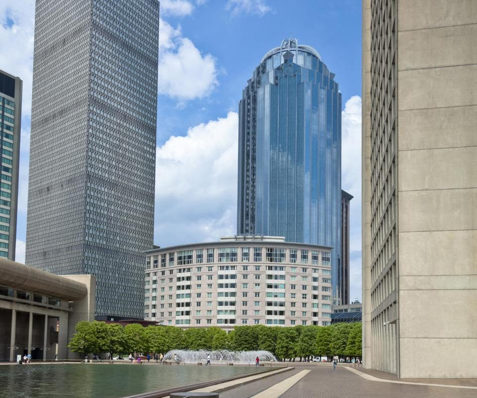 The Prudential Center complex rises behind the Christian Science Plaza's reflecting pool.