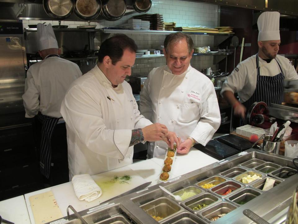 Clockwise from top right: Executive chefs Rick Tramonto (left) and John Folse preparing crab beignets; the dining room at R'evolution; a jewel box of confections.
