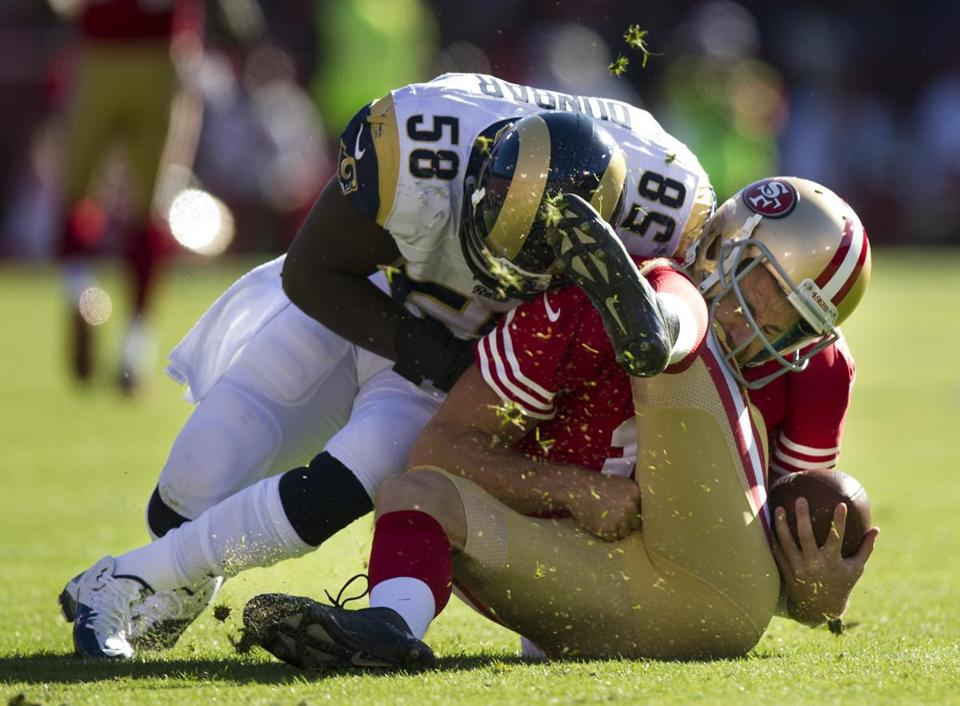 San Francisco 49ers quarterback Alex Smith (right) got a concussion when he was tackled by St. Louis Rams linebacker Jo-Lonn Dunbar in November.