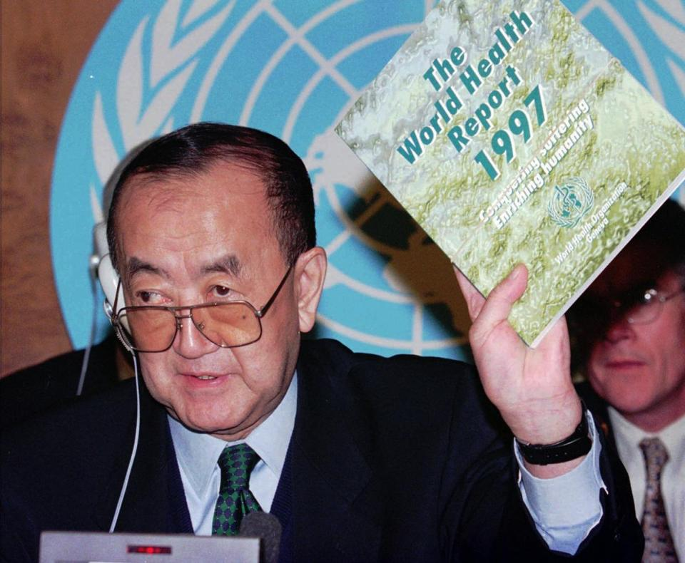 Dr. Nakajima with a World Health Organization report. His term ended in 1998.