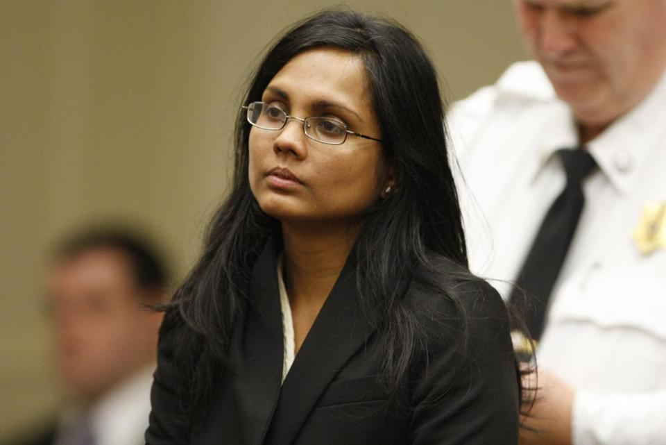 Annie Dookhan, a former chemist at the Hinton State Laboratory Institute, listened to the judge during her arraignment at Brockton Superior Court in Brockton, Massachusetts January 30, 2013.