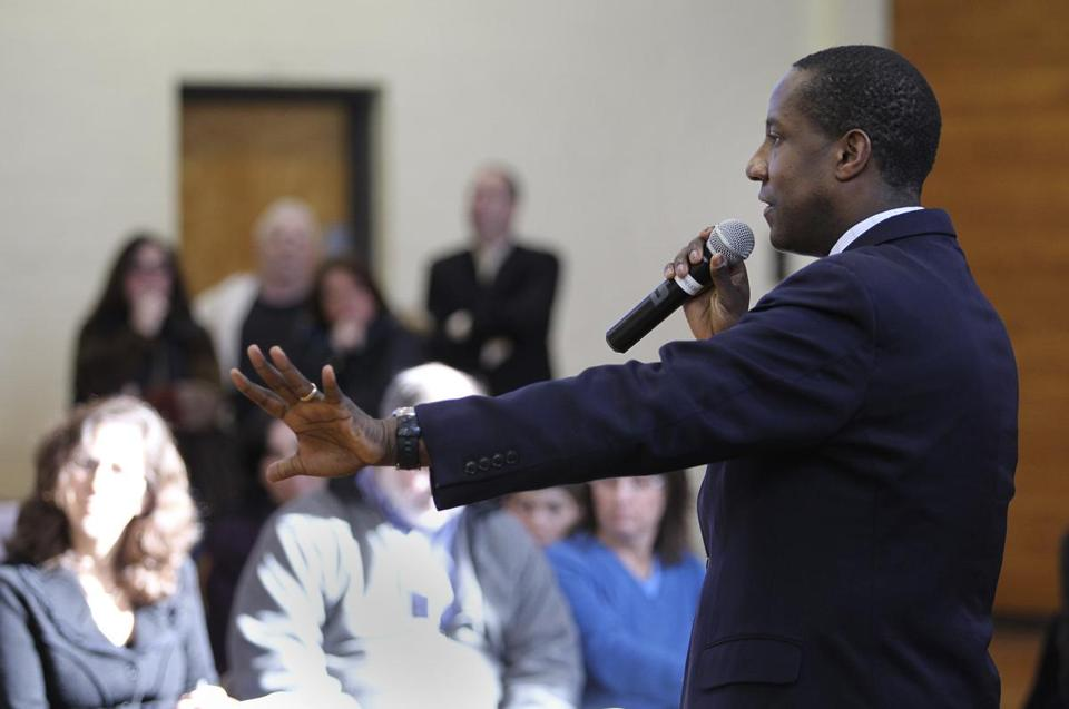 Newton Mayor Setti Warren speaks to a group at the Pellegrini Field House concerning the city's proposed hefty tax increase in March.