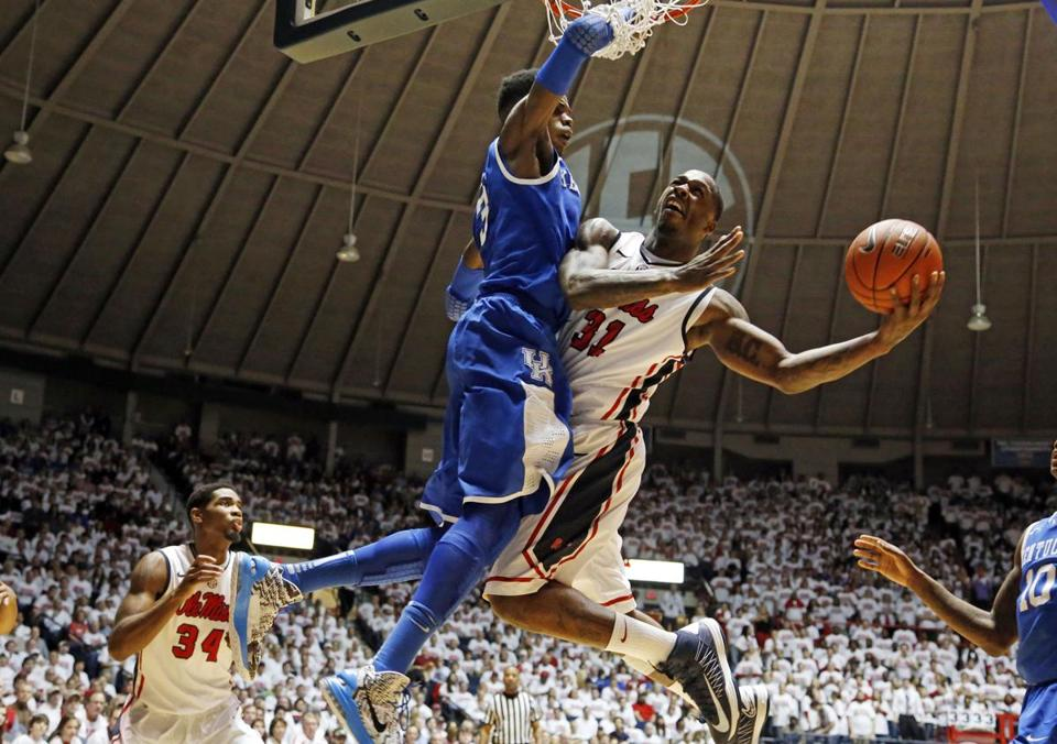 Kentucky's Nerlens Noel reached up to block a layup attempt by Mississippi forward Murphy Holloway in the second half.