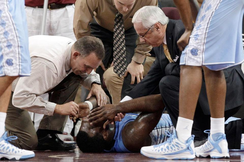Tar Heels star P.J. Hairston had to be carted off on a stretcher late in the first half and later was diagnosed with a concussion.