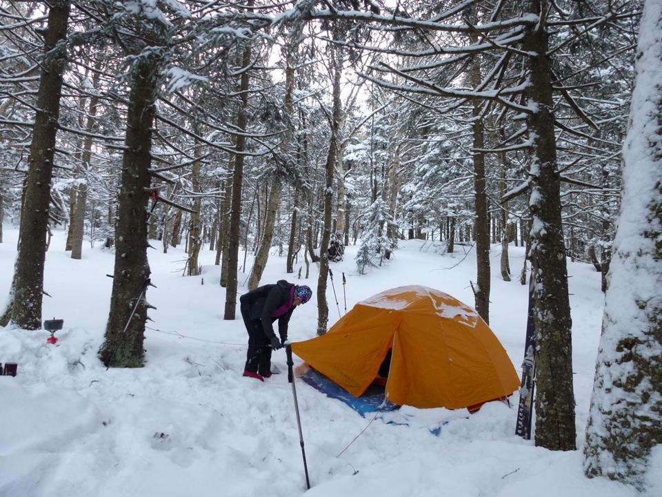 The author sets up the tent in a clearing away from possible falling branches — or trees — in Mount Mansfield State Forest in Vermont.