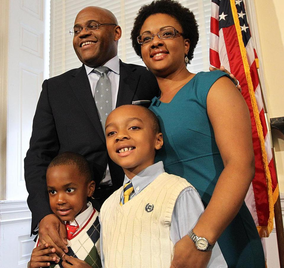 "William ""Mo'' Cowan, shown with his wife, Stacy, and sons Grant and Miles, was going to return to the private sector."