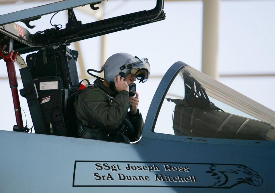 Air Force Major Scott Snider prepared for a flying exercise.