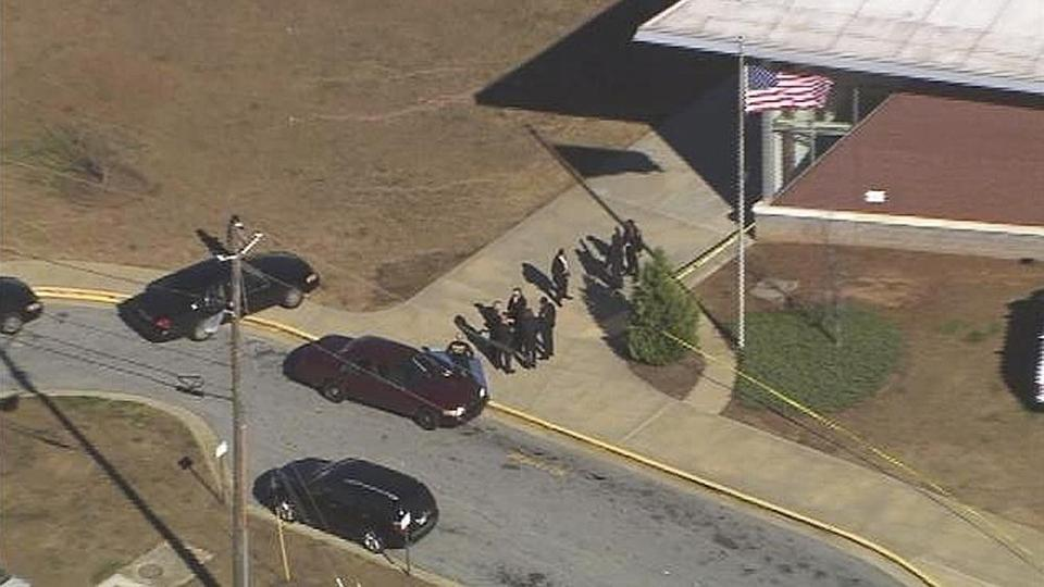 Authorities investigated the scene of a school shooting in Atlanta.