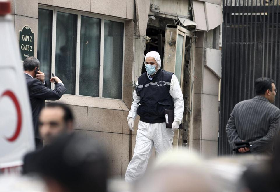 Emergency personnel worked in front of a side entrance of the US Embassy in the Turkish capital, Ankara, after a suspected suicide bomber detonated an explosive device Friday.