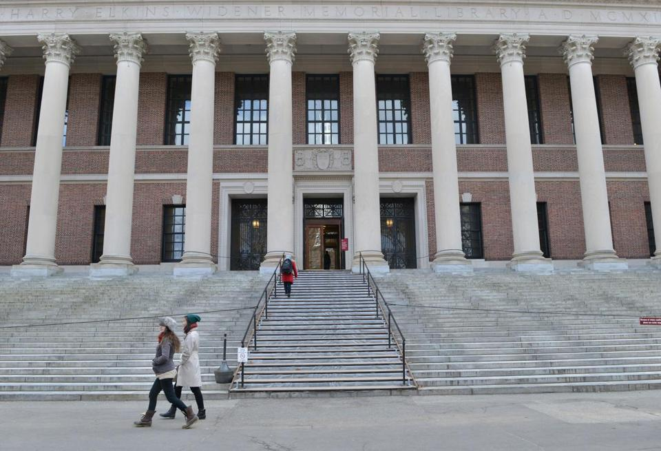 Pedestrians walk past the Widener Library at Harvard University campus after recent news about disciplinary actions resulting from the cheating scandal. JOSH REYNOLDS FOR THE BOSTON GLOBE (Metro, Landergan)