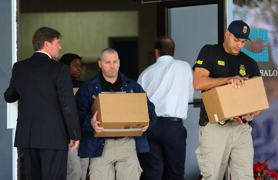 FBI agents carried boxes from this week's raid on the offices of Dr. Salomon E. Melgen.