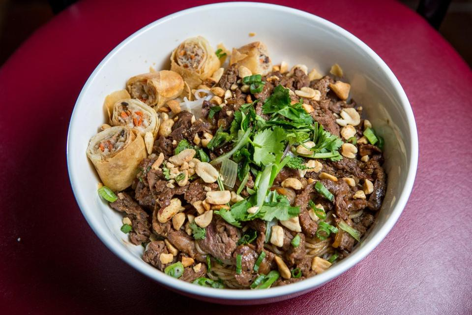 Duy Tran, the 25-year-old owner of DooWee & Rice in Somerville, serves up such dishes as (from top) Vietnamese marinated beef noodles, spicy soy chicken wings, and pork baobaos.