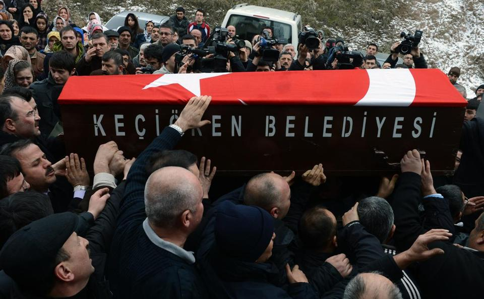 Mourners carried the Turkish flag-covered bier of Mustafa Akarsu, an American embassy security guard killed when a suicide bomber struck the US embassy in Turkey on Friday.