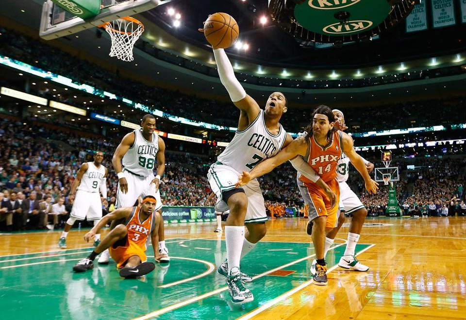Jared Sullinger of the Boston Celtics pulled in a rebound in front of Luis Scola of the Phoenix Suns Jan. 9, 2013 at TD Garden.