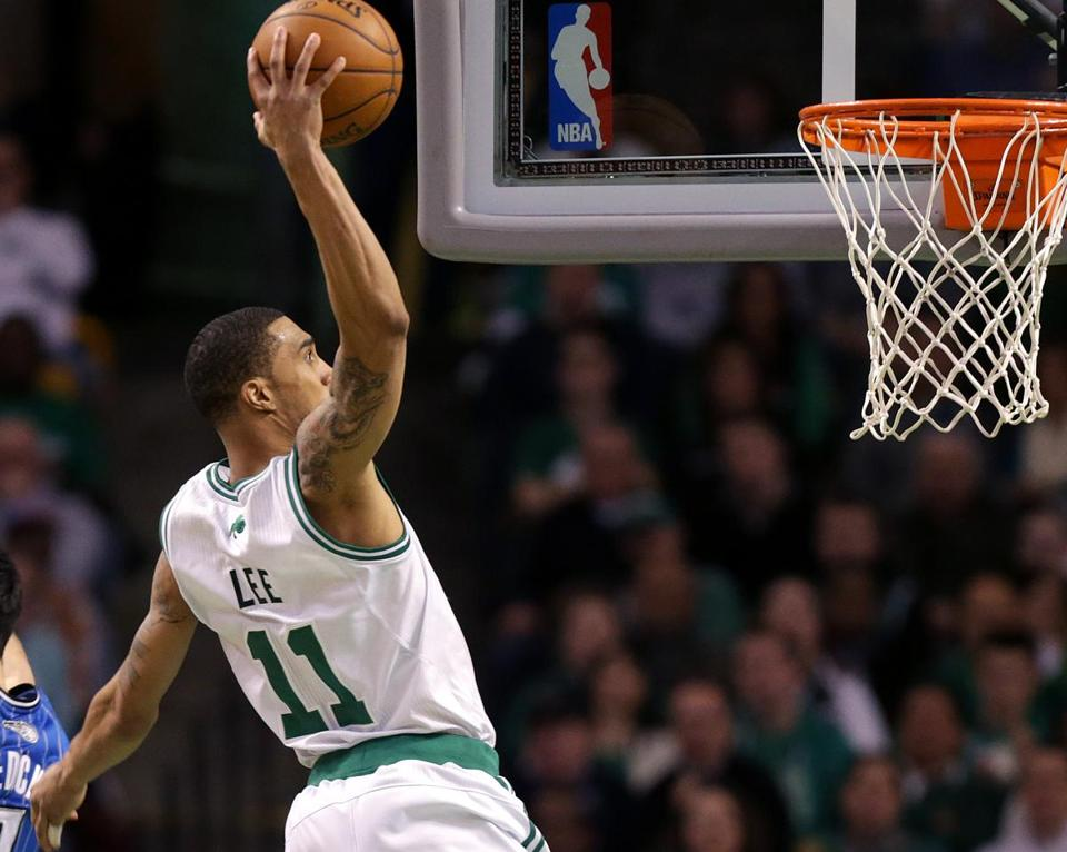 Guard Courtney Lee, slamming home 2 of his 14 points, was one of six Celtics to score in double figures.