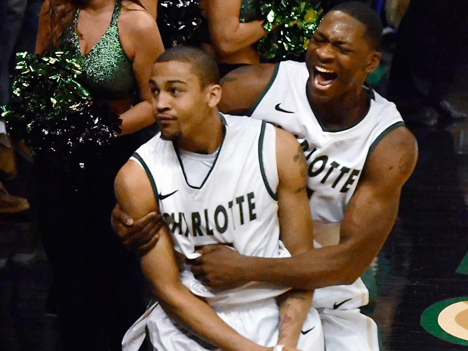 After making a game-clinching steal, Charlotte's Pierria Henry (left) celebrates an Atlantic 10 victory over UMass with Willie Clayton.