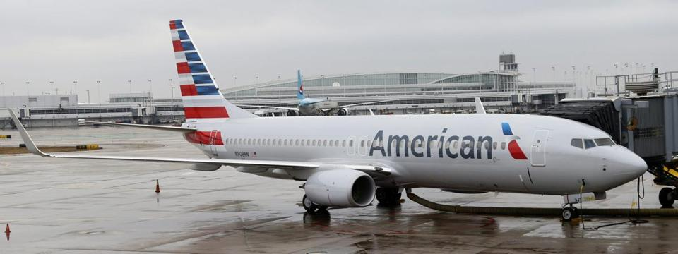 An American Airlines 737-800 aircraft with a new painting and the company's new logo was at a gate at O'Hare International Airport in Chicago.