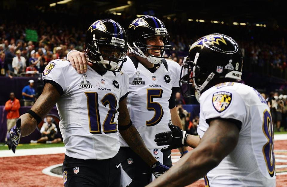 Jacoby Jones, Joe Flacco, and Anquan Boldin of the Baltimore Ravens celebrated after Jones caught a 56-yard touchdown pass from Flacco in the second quarter.