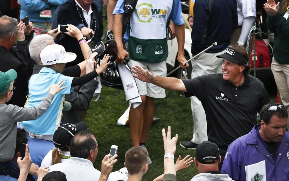 Phil Mickelson, always a fan favorite, got the crowd into the act as he ran away with his third Phoenix Open victory.
