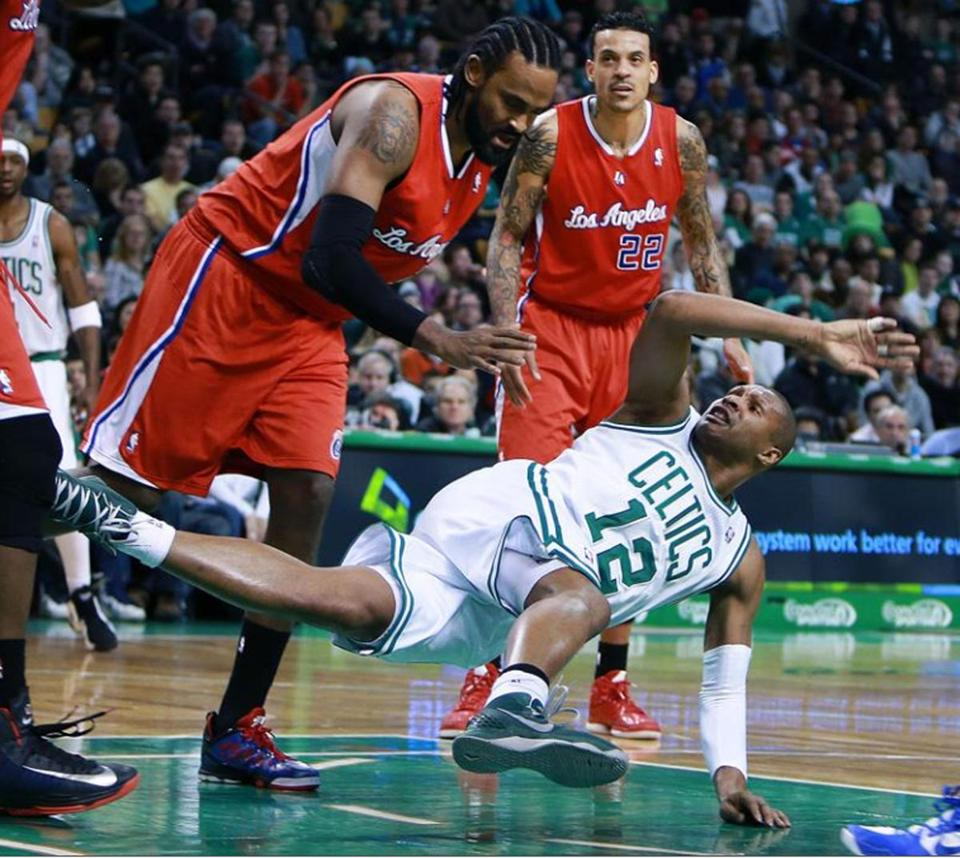 Although it wasn't called a flagrant foul, the Celtics' Leandro Barbosa hits the deck hard courtesy of the Clippers' Ronny Turiaf (left).