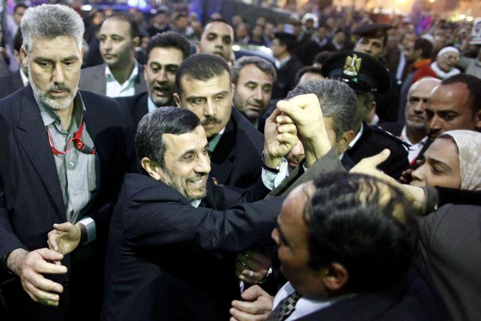 Mahmoud Ahmadinejad arrived in Cairo in the first visit by an Iranian head of state to Egypt in more than 30 years.