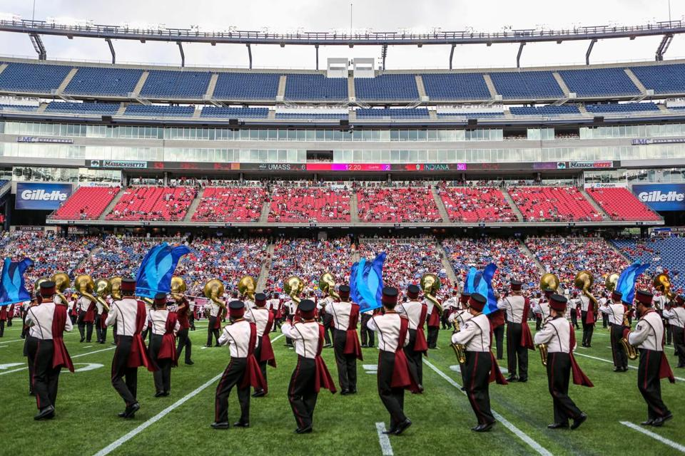 The UMass marching band performed during a game between the UMass Minutemen and the Indiana Hoosiers.
