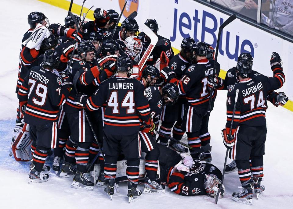 Northeastern players celebrated the school's first win over BU in the Beanpot since 1988.