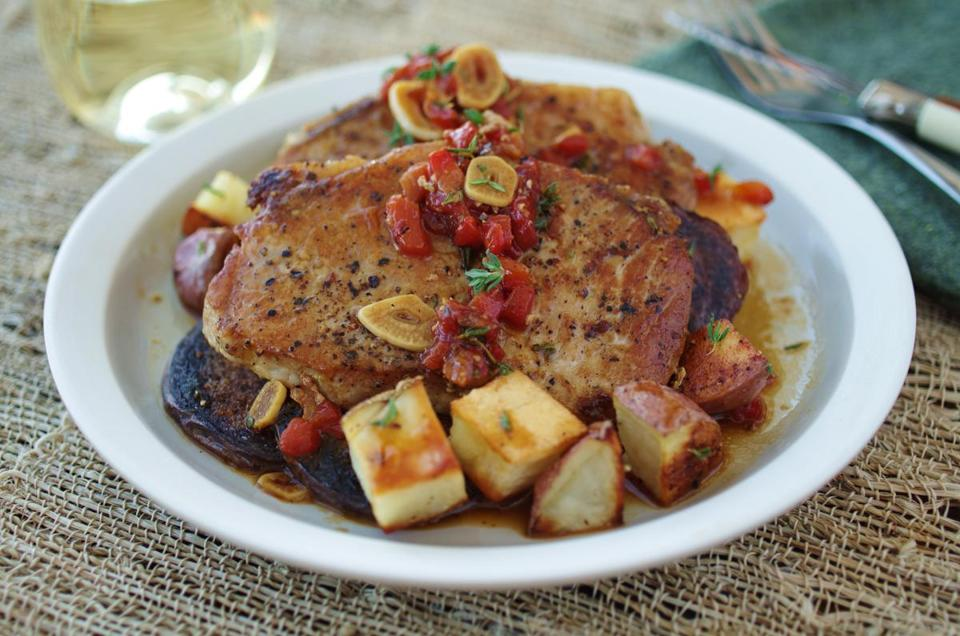 Pork chops with toasted garlic and roasted red pepper.