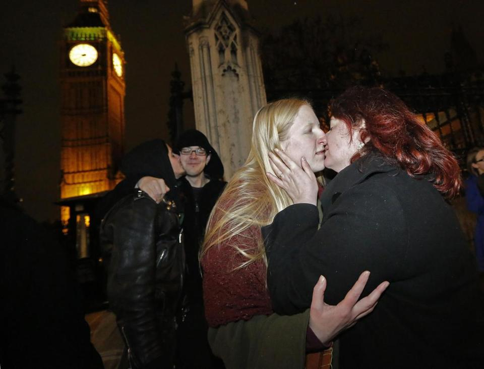 Elizabeth Maddison (left) kissed her civil partner Hannah Pearson after she proposed marriage in London Tuesday.