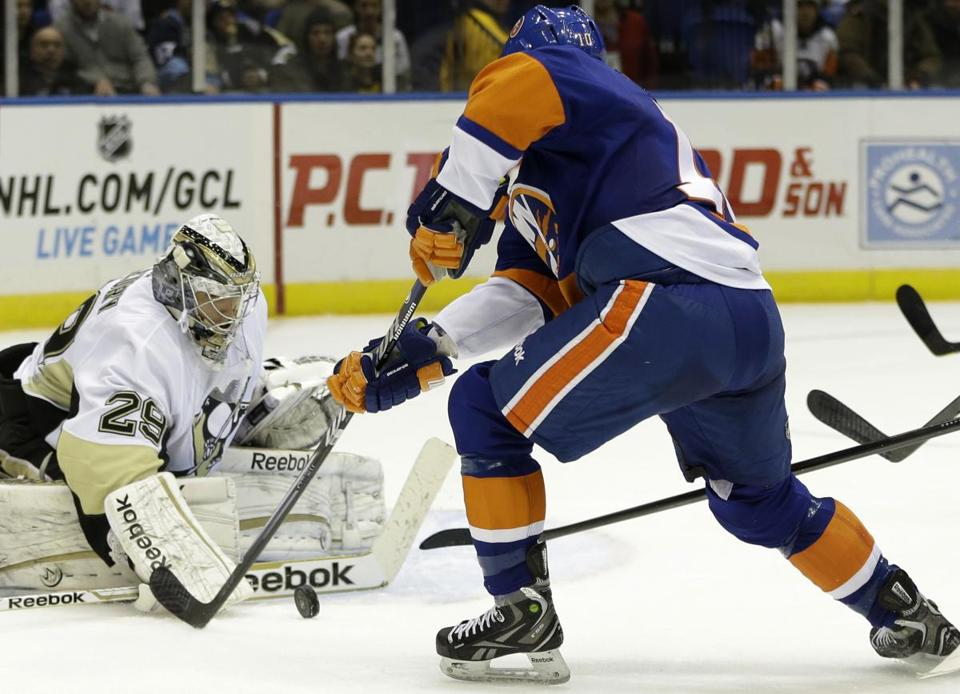 Penguins goalie Marc-Andre Fleury made a save on Islanders center Keith Aucoin in the second period.